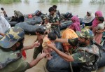 Pakistani Navy personnel bring flood sur